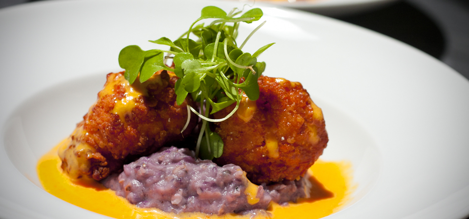 Buttermilk-Fried-Chicken-Anson-Mills-blue-Corn-Grits-Red-Pepper-Pernod-Cream